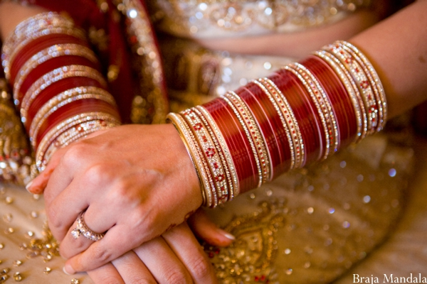 Indian bride with red churis, traditional Indian bridal jewelry.