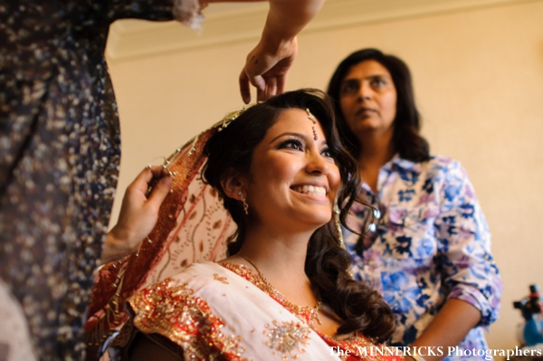 Indian bride puts on her chuni, a part of her indian bridal lengha.