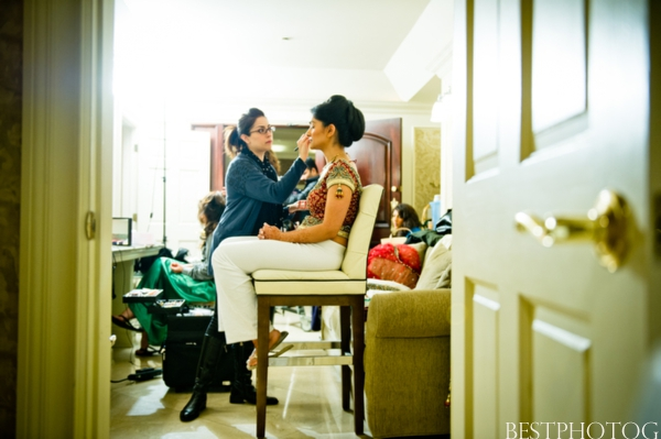 An Indian brides gets her Indian bridal hair and makeup completed.