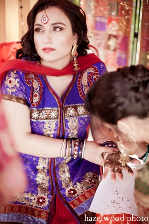 An Indian bride receives bridal mehndi.