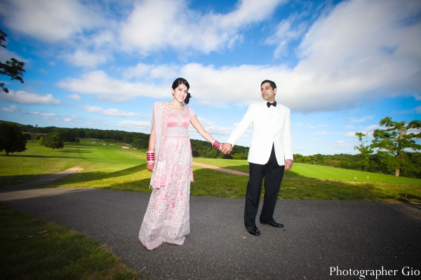 An Indian bride and groom take professional Indian wedding photography before the reception.