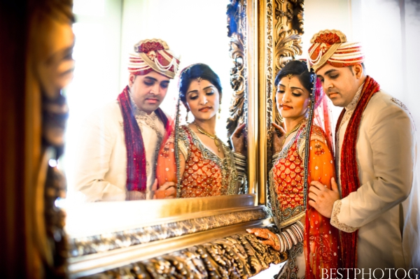 An Indian bride and groom embrace in these Indian wedding photography set.