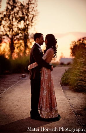 An Indian bride and groom at their sunset indian wedding reception.