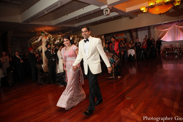 Indian bride and groom enter their hollywood theme wedding reception.