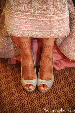 Closeup of bridal mehndi on feet on an indian bride.