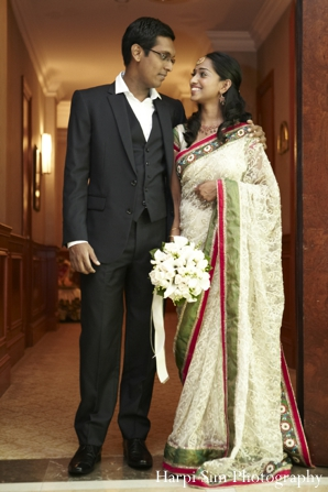 An indian bride wears a light green bridal sari with her new husband.