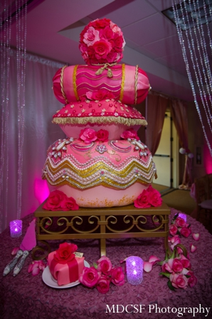 Indian wedding cake pillow stack at modern Indian wedding reception.