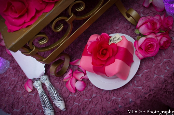 Close up of indian wedding cake with mini cake treat.
