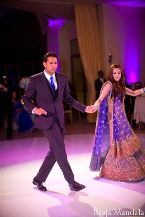 An indian wedding reception in purple and gold.