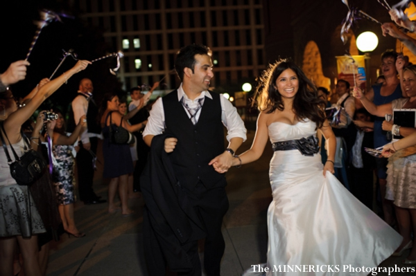 An indian bride and groom leave their indian wedding reception in dallas, texas.
