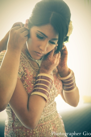 An Indian bride puts on an Indian bridal jewelry set for her reception.
