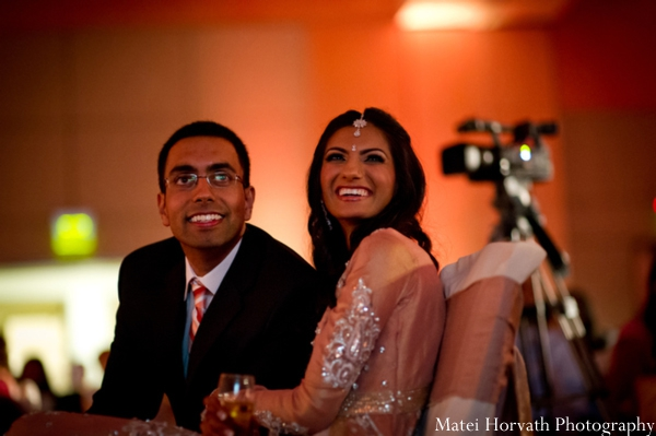 An Indian bride and groom at their modern Indian wedding reception.