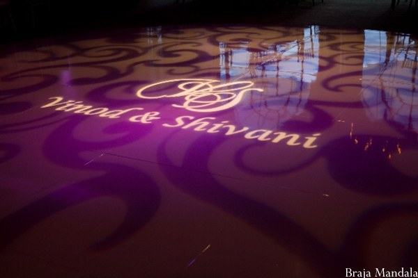Indian wedding decor ideas of monogram initials on dance floor.
