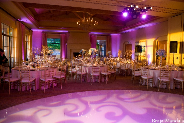 Indian wedding reception ideas with purple and gold lighting.