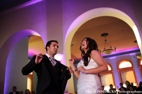 Indian bride and groom dance at their fusion indian wedding reception.
