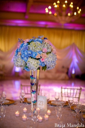 Indian wedding reception centerpiece of hydrangea flowers.