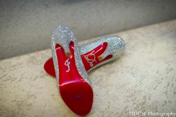 Indian bridal shoes in silver with initial gems at the sole.