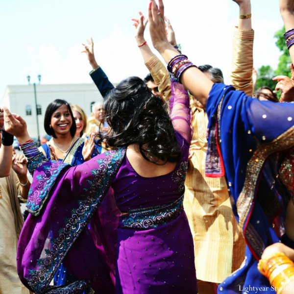 Indian wedding photography captures dancing at baraat.