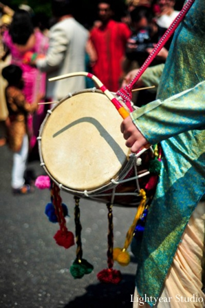 Live dhol player at indian wedding baraat.