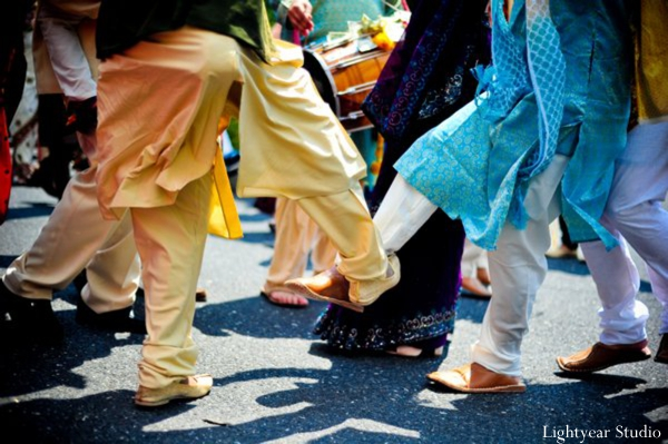 Indian wedding baraat dancing on the street.