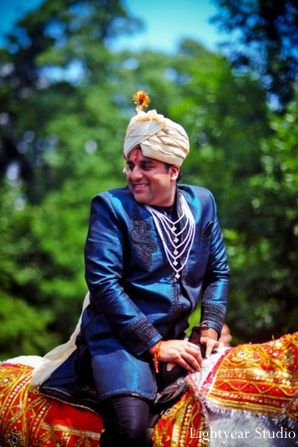Indian groom rides into an Indian wedding baraat.