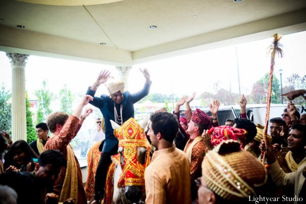 Indian wedding begins with Indian groom at his baraat.
