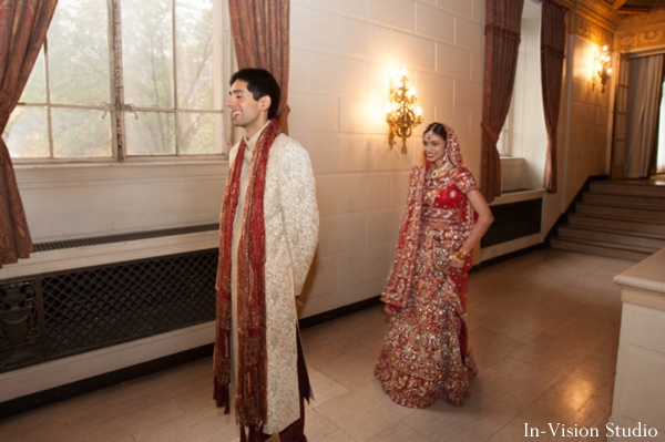 Indian bride and groom at their first look photos