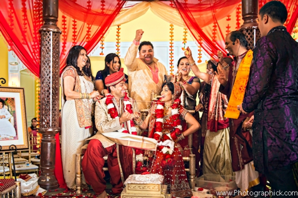 Indian bride and groom under a mandap.