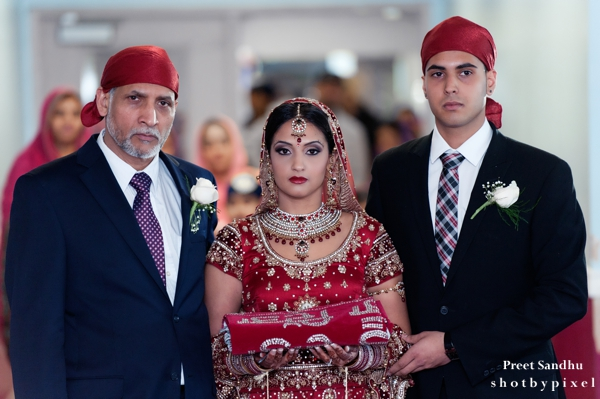 Indian bride walks into her sikh indian wedding ceremony.