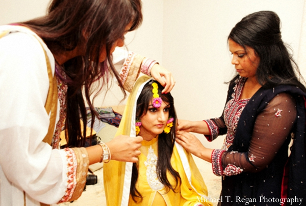 Pakistani bride in yellow wedding outfit.