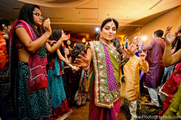 Indian bride dances at her traditional garba Indian wedding ceremony.