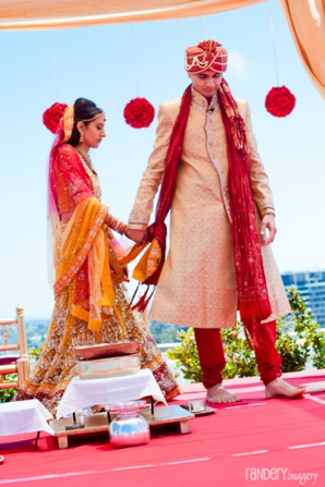 Indian bride and groom under indian wedding ceremony mandap