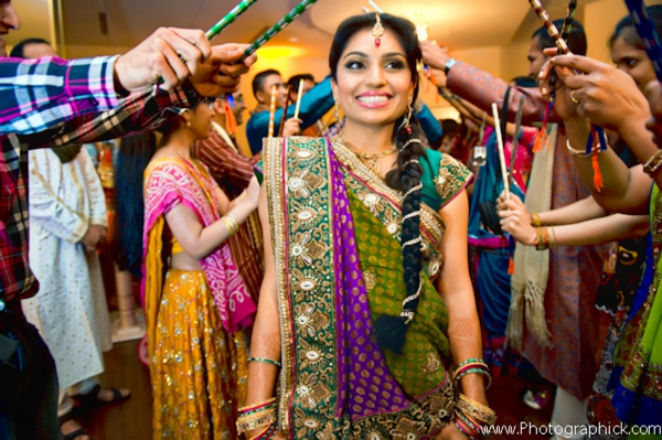 Indian bride in bridal sari enters garba.