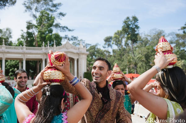 Indian wedding begins with bridesmaids holding coconuts.