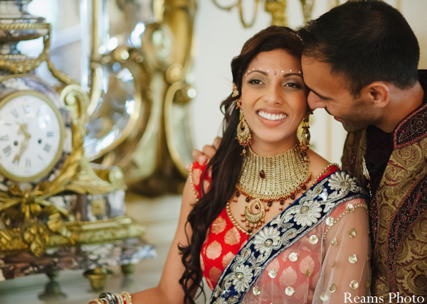 Indian bride wears bridal lengha and traditional bridal jewelry.