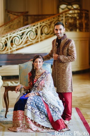 Indian bride and groom pose for portrait before indian wedding ceremony.