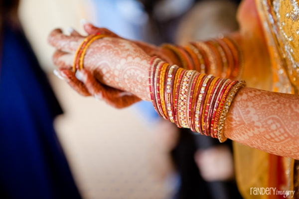 Indian bride has bridal mehndi and wears indian bridal jewelry.
