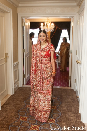 Indian bride wears a red wedding lengha.