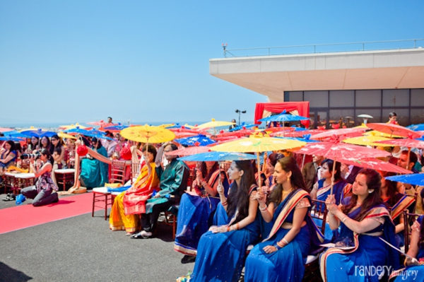 Outdoor indian wedding ceremony in blue saris.