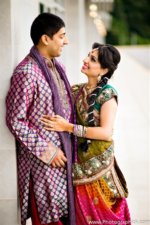 Indian bride and groom at their traditional wedding garba.