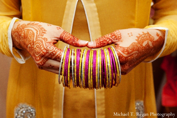 Pakistani bride has mehndi hands for her Pakistani wedding.