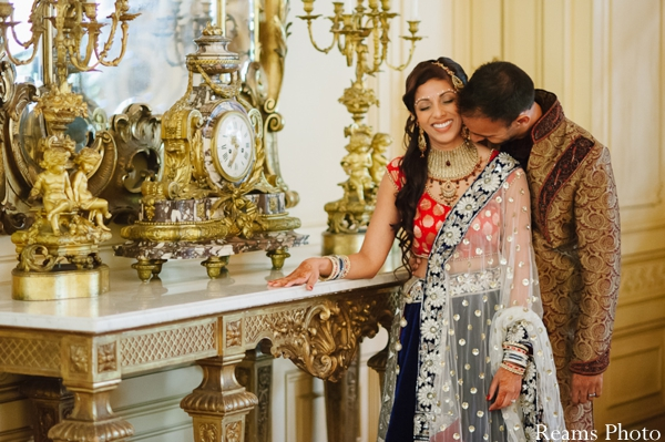 Indian bride wears pink and navy bridal lengha.