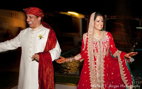 pakistani bride and groom enter their pakistani wedding reception.