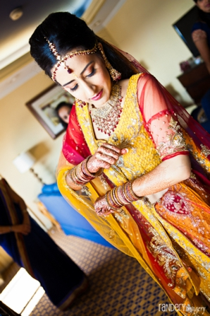 Indian bride gets ready in traditional indian lengha.
