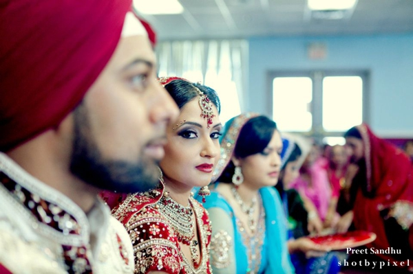 Indian bride at her Sikh indian wedding with hair and makeup ideas.