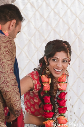 An indian bride wears a traditional indian wedding jaimala.