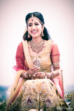 indian bride in traditional wedding lehenga.