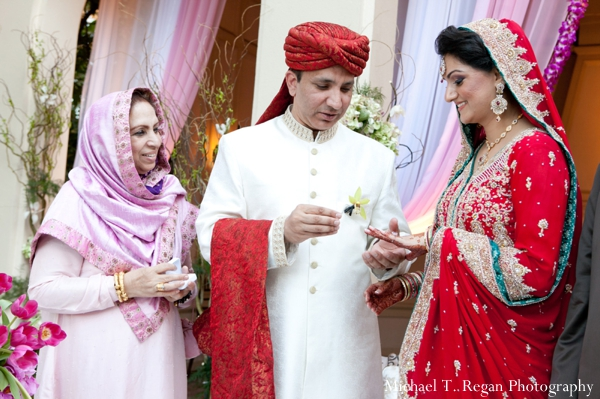 pakistani bride and groom exchange rings at this wedding ceremony.