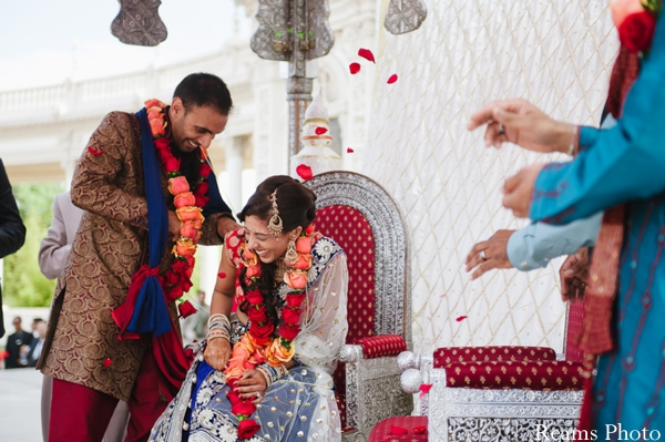 Roses petals thrown at indian bride during indian wedding ceremony.