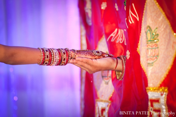 Indian bride wears traditional indian wedding bangles.